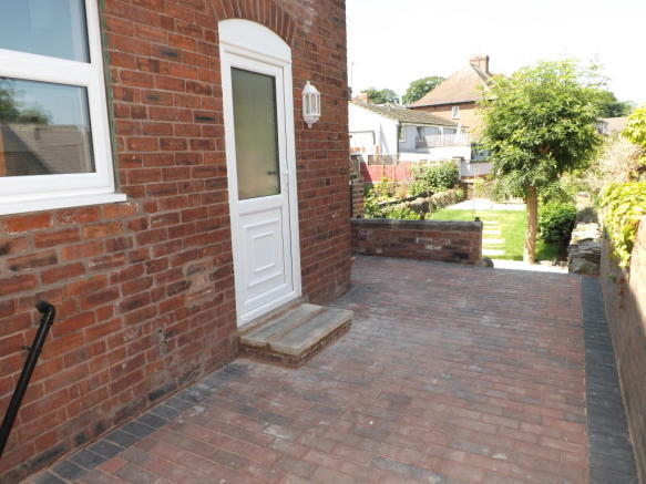 Outside paved area leading to garden