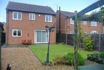 Detached home in Plough Lane, Newborough...