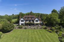 Detached home in Itchingwood Common Road...