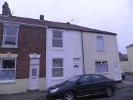 Terraced home in South Cliff Road...