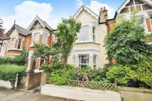 Terraced property in Brookwood Road...