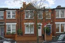 Terraced home in Garfield Road, Wimbledon...