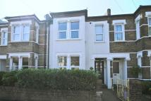 Terraced property in Ridley Road, Wimbledon