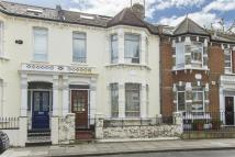 Terraced home for sale in Normand Gardens...