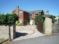 Detached home in High Street, Langford,