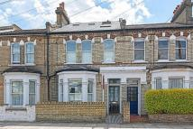 3 bed house in Brookville Road, London...