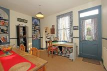 Terraced property in Hereward Road, London...