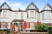 Terraced house in Palermo Road, London...
