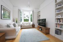 Terraced property in Hartland Road, London...