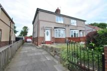 semi detached house in Station Road North...