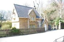 Detached house for sale in The Lodge, The Village...