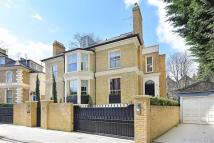 Detached home in Addison Road, London