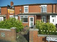 Terraced house in Bolton Road, Aspull