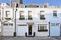 Terraced home for sale in Eaton Mews North, London...