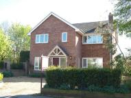 Detached house in High Street, Tilbrook
