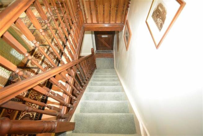 STAIRS RISING FROM THE LOUNGE TO