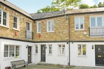 2 bedroom property in Coach Yard Mews, London...