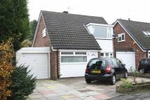 Link Detached House in Caldy Road, Handforth...
