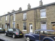 Terraced property in Surrey Street, Glossop...