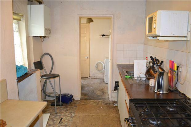 Kitchen through to utility room
