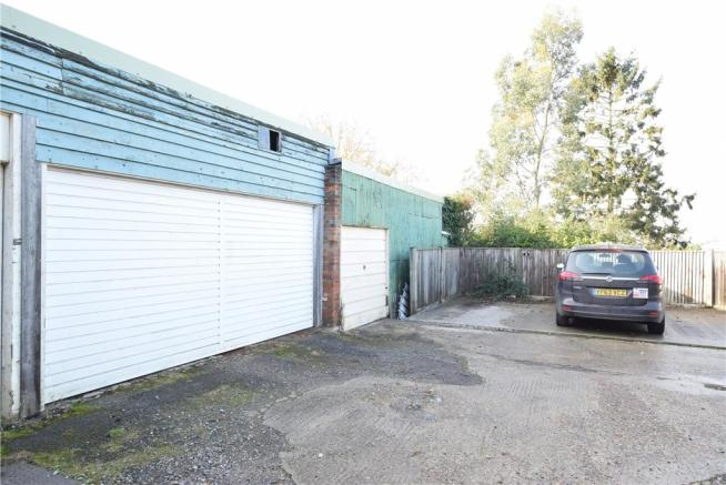 Double Garage, Single Garage, 2 Parking Space and Workshop