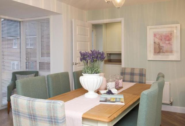 Typical Tetbury dining area with glazed bay and French doors