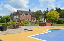 Detached property for sale in High Street, Colton...