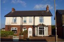 semi detached house in Huddersfield Road...