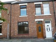 Terraced house to rent in Ravensworth Avenue...