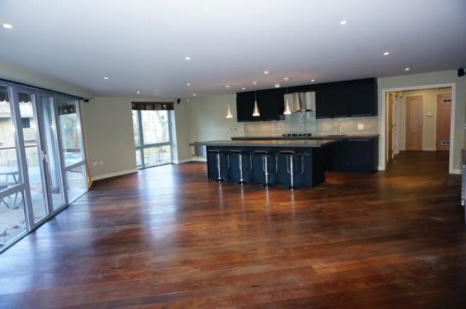 Open Plan living room leading to private balcony