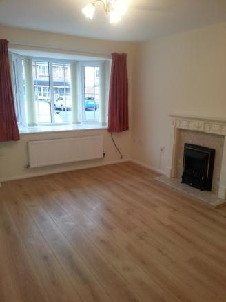 Lounge with laminate flooring and electric fire su