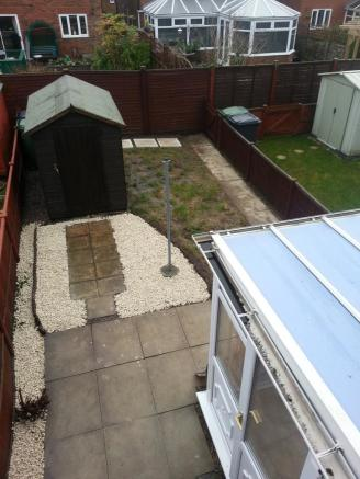 Rear enclosed garden with shed