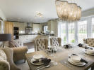 Open plan kitchen / dining with French doors