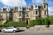 Flat in 211/2 Newhaven Road...