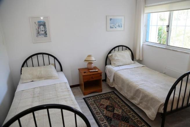 one of twin bedrooms