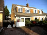 semi detached property in 25 Powys Gardens...