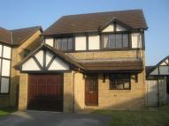 Detached home in Woodcote Green...