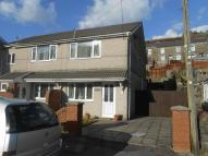 semi detached home in Station Row, Nantymoel...