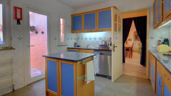 kitchen adjacent to dining room