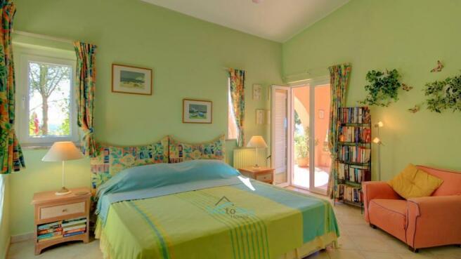 bedroom 3 with doors to terrace