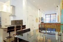 Flat to rent in 65 Bolsover Street...