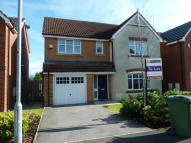 Detached property in 14 Higher Clough Close...