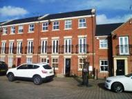 Terraced home in Brass Thill Way...