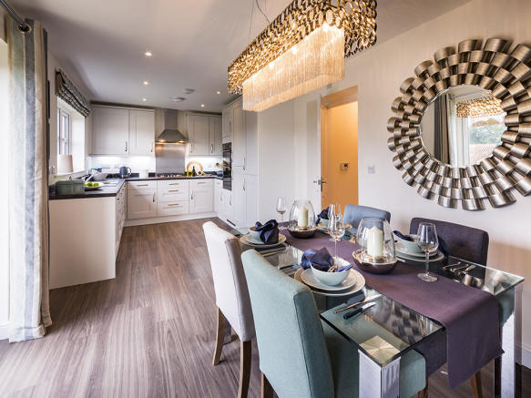 Integrated kitchen and dining area with AEG/Electrolux appliances