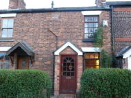 Terraced property in Rushgreen Road, Lymm...