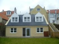 property in High Street, Kinghorn...
