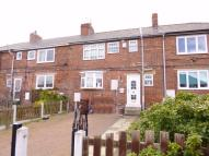 Terraced property in Longfields Crescent...