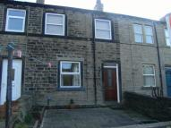 property in Meltham Road, Netherton...