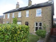 Terraced property in Station Road, Shepley...