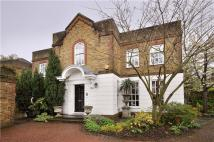 Detached house in Hambledon Place, London...